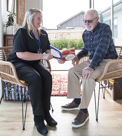 Claire Fisher discusses the importance of exercise alongside medication with client Graeme Blackburn.