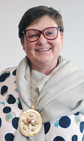 Heather Symes wearing the presidential chain