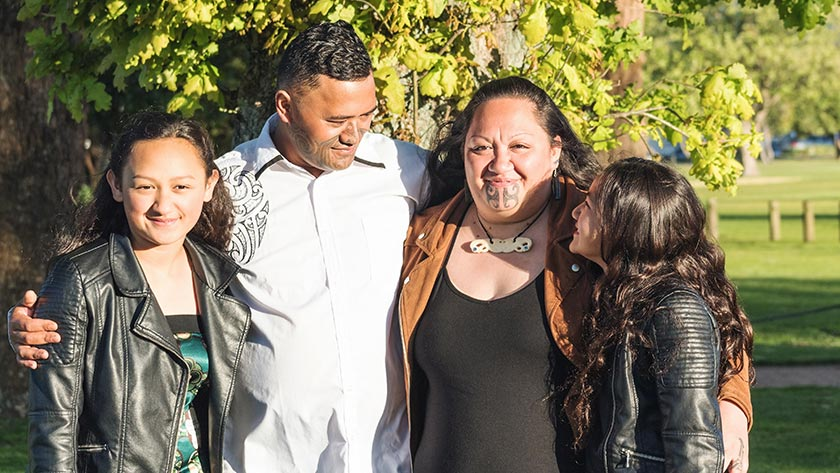 Portrait of a young Māori family taken outdoors