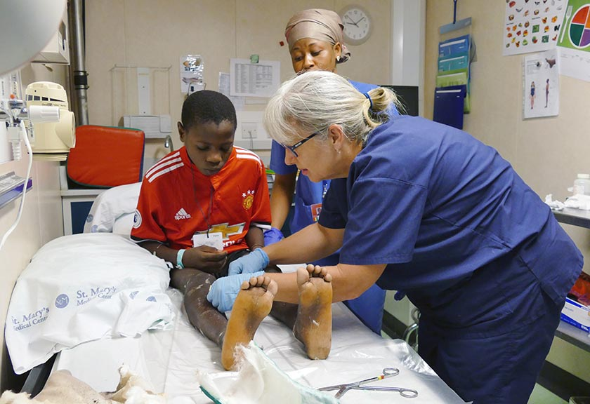 Robyn Ferguson taking care of a young patient on the Africa Mercy