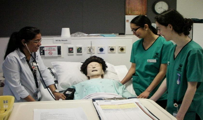 Simulation learning: Lecturer Omana Thomas using a mannequin to guide students on how to deal with a patient with chest pain.