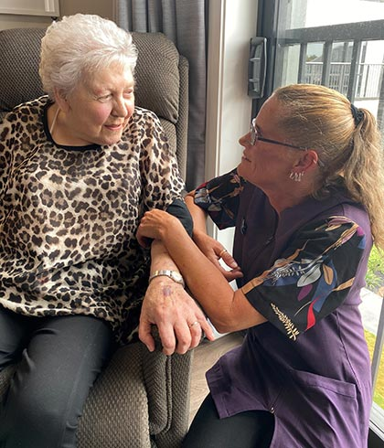 Health-care assistant Dawn Jenkins with Mary Booker.