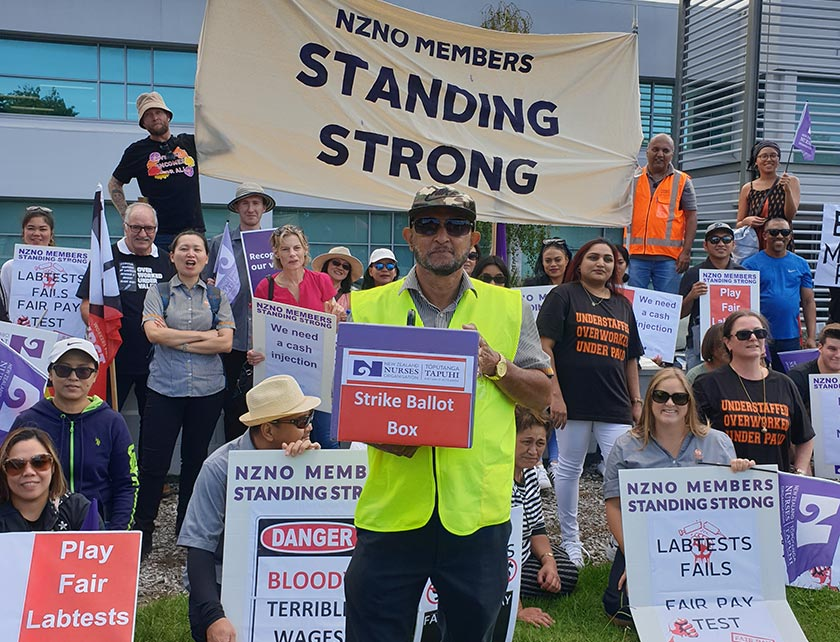 NZNO members picket outside Labtests head office in Mount Wellington, Auckland, last month.