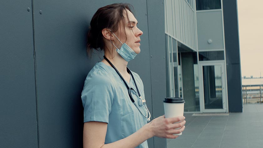Exhausted nurse on a coffee break