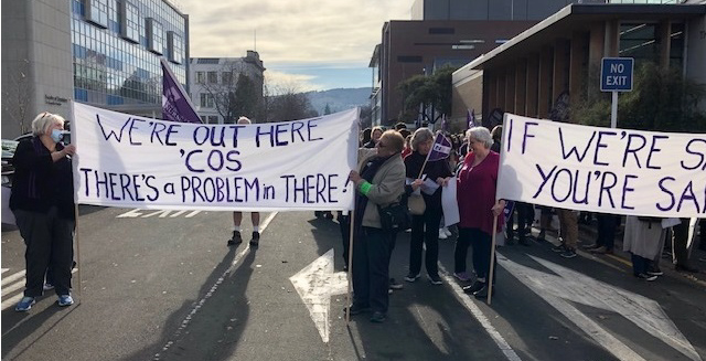 Dunedin nurses with banners prepare to march