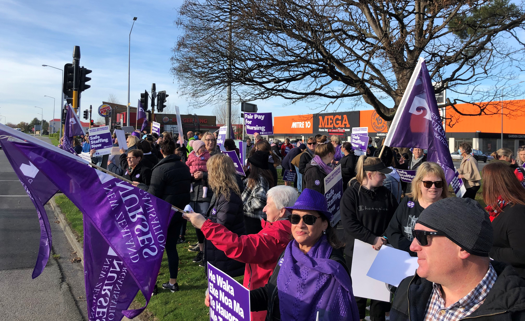 Large group of nurses on side of road in Invercargill