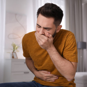Young man suffering from nausea.