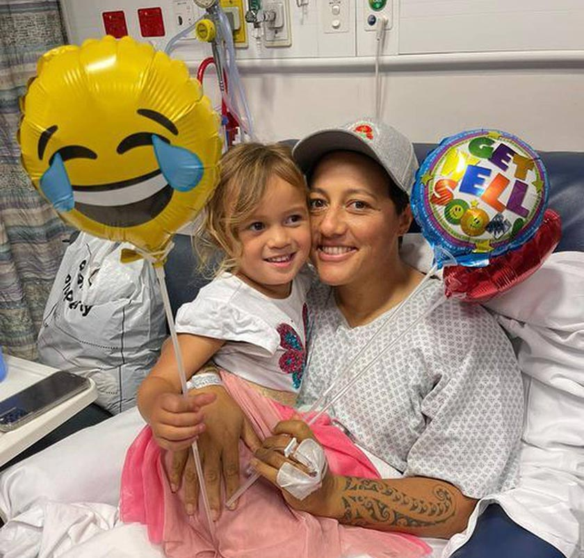 Labour MP Kiritapu Allan in a hospital bed with daughter Hiwaiterangi and balloons.