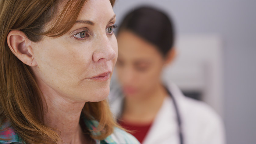 Tight shot of female patient waiting for doctor to examine her.